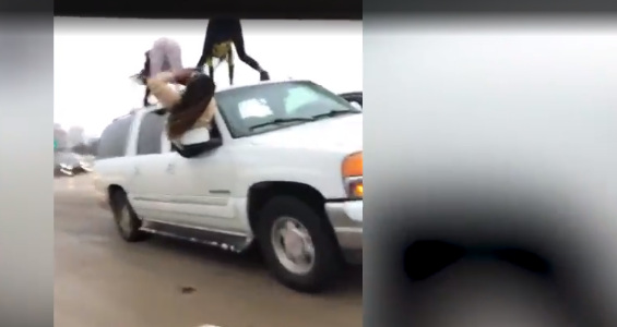 women twerking on top of suv shaking their ass as car moves along highway