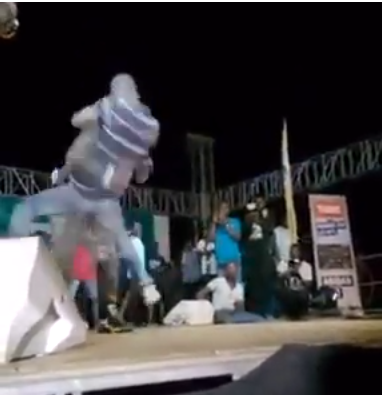 gay man jumping on Jamaican singer